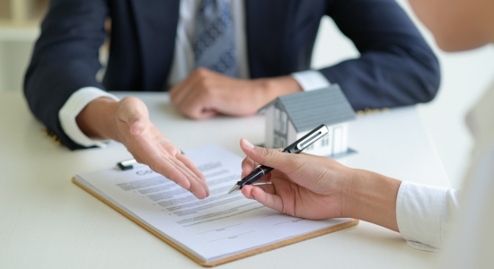 The home broker recommends the client to sign the contract,Real estate concept.